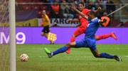 Carlos Bacca of Sevilla scores his team's second goal