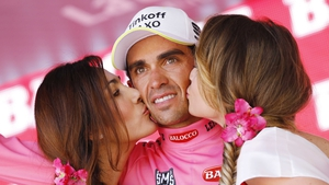 Alberto Contador gazes into the distance as he is congratulated on extending his lead in the GC