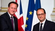 David Cameron shaking hands with Francois Hollande during a press conference in Paris