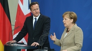David Cameron and Angela Merkel speak to media following talks at the Chancellery in Berlin, Germany