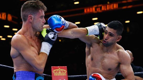 Amir Khan (R) in action against Chris Algieri