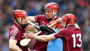 Dublin's Ryan O'Dwyer is tackled by Joe Canning, Jonathan Glynn and Cathal Mannion of Galway during the Leinster hurling quarter-final clash at Croke Park