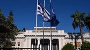 Greek and EU flags outside the Prime Minister's office in Athens