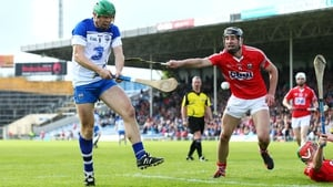 Waterford's Tom Devine scores a goal in the league final despite the efforts of Cork's Mark Ellis