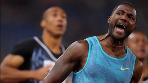 Justin Gatlin shows his delight at the finish line