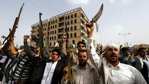 Supporters of the Houthis in Yemen carry guns during a rally protesting Saudi-led military operations