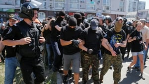 Policemen block anti-gay protesters during the Gay pride parade in Kiev