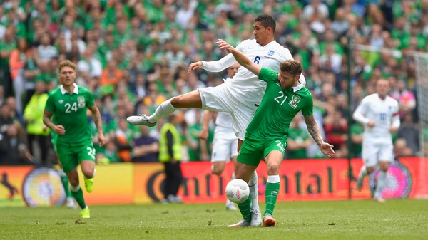 Chris Smalling and Daryl Murphy battle for the ball