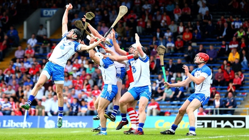 Waterford's Barry Coughlan catches a high ball over Pa Cronin of Cork