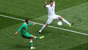Ireland's Aiden McGeady attempts to cross a ball past England's Phil Jones