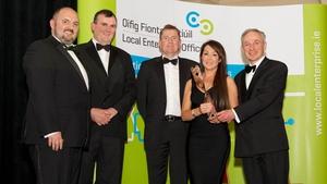 MyBio's Linda Nolan receiving her National Enterprise Award from Jobs, Enterprise and Innovation Minister Richard Bruton