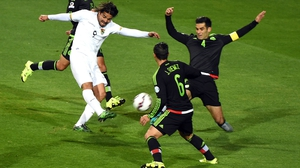 Bolivia's forward Marcelo Moreno is marked by Mexico's Rafael Marquez (R) and midfielder Javier Guemez (2-R)