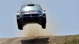 Sebastien Ogier's Volkswagen Polo R takes off at the top of a crest on the Rally Italia Sardegna