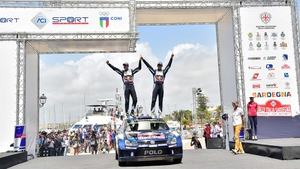 Sebastien Ogier and co-driver Julien Ingrassia celebrate victory in Sardinia