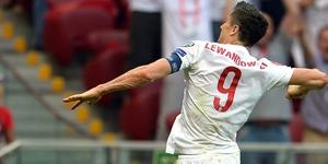 Robert Lewandowski's late hat-trick helped Poland to a vital win