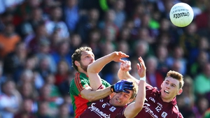 Galway's Gary O'Donnell and Tomas Flynn battle with Tom Parsons