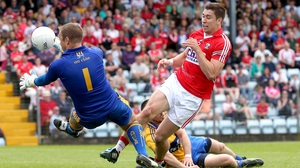 Cork's Conor Dorman has his shot saved by goalkeeper Joe Hayes of Clare