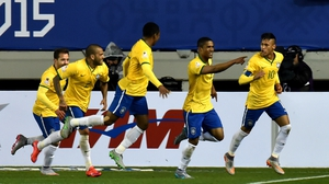 Brazil's Douglas Costa celebrates with Neymar (R) and teammates after scoring against Peru