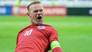 Wayne Rooney celebrates after scoring England's winner in Slovenia