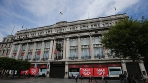 "Tánaiste Joan Burton described the actions of the owners of Clerys as ""predator capitalism"""