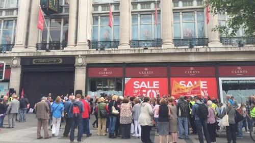 Workers and supporters gather under Clerys clock for a protest over its sudden closure