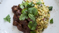 Moroccan Goat Tagine with Bulgur Wheat Salad - Goat lends itself wonderfully to rich spicing and punchy aromatics, as this tagine demonstrates. It is particularly good if made ahead of time and reheated a day or two later.