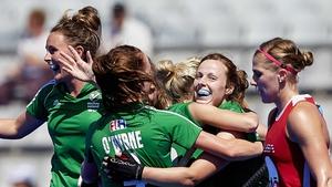 Megan Frazer and the Ireland players congratulate Anna O'Flanagan on scoring their second goal