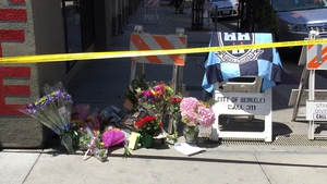 Tributes to those killed and injured have been left outside the apartment building