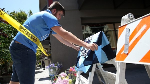 A Dublin GAA flag is placed alongside flowers for those who died in the incident