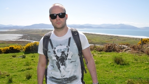 Tadhg Peavoy, with Inch Strand in the background