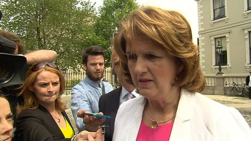 Joan Burton is calling on 'richer' Middle Eastern states to get involved in the peace initiative