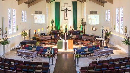 Last night relatives of four of the students who were killed received their bodies at a joint service in St Columba's Church in nearby Oakland