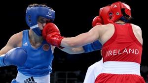 Michaela Walsh (R) lands a punch on Russia's Elena Saveleva
