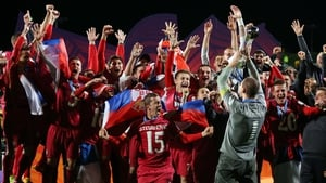 Serbia captain Predrag Rajkovic lifts the trophy after their dramatic late victory over Brazil