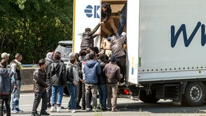 Crowds of migrants were seen trying to board waiting lorries