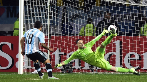 Carlos Tevez scores the winning penalty past Colombia's goalkeeper David Ospina