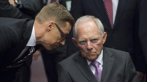 Finnish Finance Minister Alexander Stubb talks to German Finance Minister Wolfgan Schaeuble