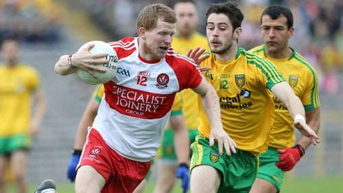 Derry's Enda Lynch tries to evade the attentions of Donegal's Ryan McHugh and Frank McGlynn
