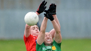Louth's Tommy Durnin goes for the ball in competition James McGrail of Leitrim