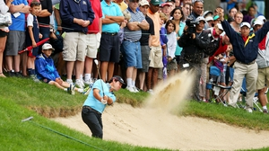 Brian Harman hits a bunker shot during the third round of the Travelers Championship