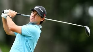Brian Harman plays his shot from the 18th tee during the third round