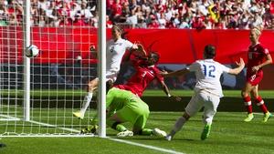 Lucie Bronze celebrates heading home England's second goal against Canada