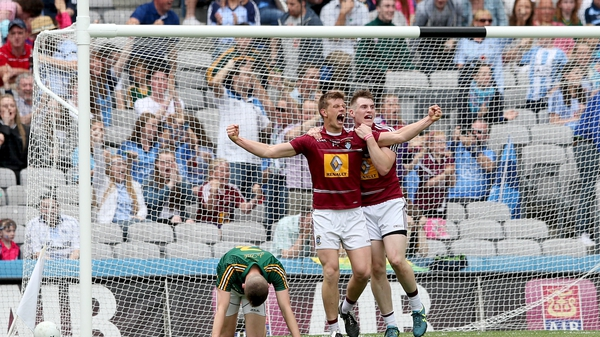 Westmeath's John Heslin celebrates scoring a late goal with Kieran Martin