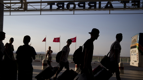 Tourists arrive at the Enfidha International airport to leave Tunisia