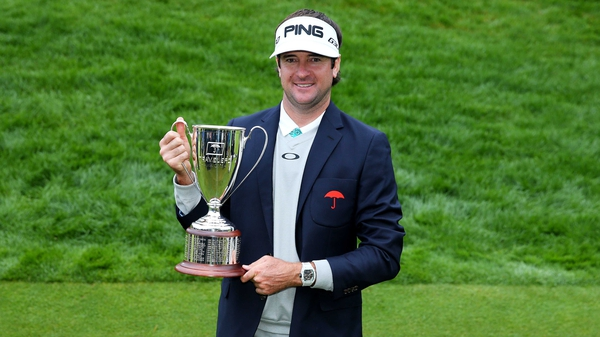 Bubba Watson with winner's trophy after the final round of the Travelers Championship at TPC River Highlands