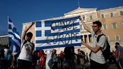 Protesters hold a flag during an anti-austerity demonstration in support of the Greek government in Athens