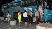 Tourists arrive at the Monastir International airport to leave Tunisia