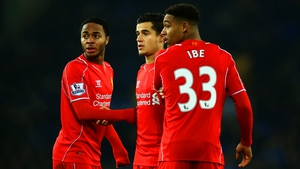 Raheem Sterling (L) and Jordon Ibe (R) in action for Liverpool