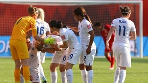 Laura Bassett of England is comforted by team mates after the game