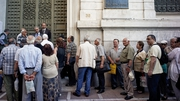 Pensioners line up outside a National Bank branch in Athens